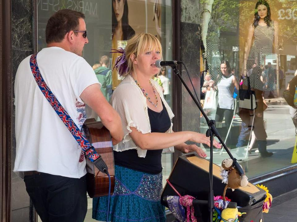 Helly and Andy busking